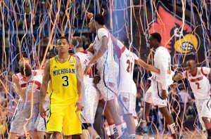 The Louisville Cardinals are the 2013 National Champions, outlasting Michigan 82-76 in the Final. Photo from Ann Arbor Photos
